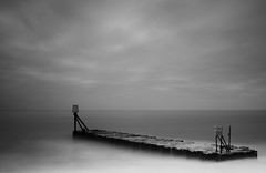 Outlet (Susie Potter) Tags: longexposure sea blackandwhite sign suffolk groyne aldeburgh outlet