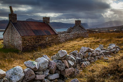 Northern Exposure (Boyd Hunt) Tags: sea chimney sun house storm grass stone wall clouds barn coast scotland highlands farm rays loch derelict beams drystone bothy