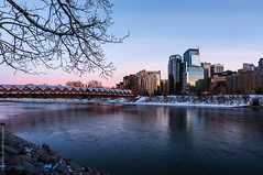 Evening at Bow river, Calgary (tuanland) Tags: city bridge winter snow canada building calgary river evening nikon downtown cityscape wide alberta bowriver peacebridge downtowncalgary d90 nikond90