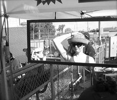 image_seen_in_a_mirror (J.Armando Serrano Photography) Tags: bw hat lady canon tampa mirror is florida streetphotography powershot digitalcamera strawberryfestival sd950 httpwwwflickrcomgroupsflickraward
