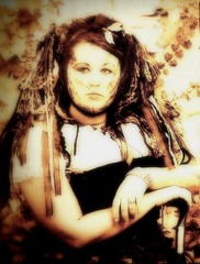 woman with veil (milomingo) Tags: park portrait woman face wisconsin female bristol fun outdoors amusement ribbons veil lace fair jewelry medieval event entertainment fantasy destination faire renfair themed seated photoart renaissancefaire themepark attraction costumed wherefantasyrules