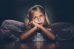 Bored with flying. (aamith) Tags: wings girl sad portrait portraiture carlzeiss zeiss bokeh dof
