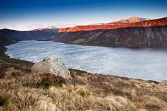 Windy Sunrise At Loch Muick ([[BIOSPHERE]]) Tags: uk shadow mountain lake snow nature sunrise landscape golden scotland windy hour lochnagar glenmuick lochmuick cairngormnationalpark caingorms
