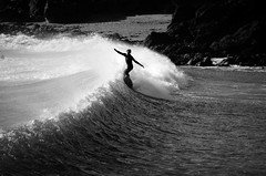 Surf's Up #2 (Louis Bamford) Tags: uk travel winter light summer bw white black hot cold beach me wet water silhouette sport swim photography nikon friend freestyle rocks cornwall surf waves arms seagull gull board rip surfing spray balance splash swag wetsuit nikond7000