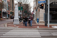 crosswalk (bill.d) Tags: winter woman man black monument sign walking downtown afternoon walk michigan unitedstatesofamerica americanflag sidewalk jacket dontwalk kalamazoo crosswalk plaid eos60d wmichiganave skalamazoomall