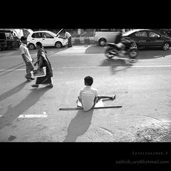 Longing (Sathish_Photography) Tags: boy india white motion black streets photography photo small feel madras beggar photowalk chennai tamilnadu longing sathish mim attacked polio thiruvanmiyur