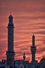 Mosques Rising (huskyte77) Tags: city trip travel november sunset red vacation sky orange white black building tower weather architecture clouds contrast canon eos flickr dubai day view cloudy outdoor united uae mosque emirates arab modified gps oriental range unitedarabemirates deira 100400mm 2012 topaz dubayy deiradubai d85 canoneos1dmkiii baniyasroad