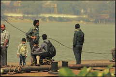 Just a casual capture. (soumen19xx) Tags: people india blur color green water leaves fauna 1025fav digital photoshop canon bag geotagged photography eos kid clothing focus waiting asia moments natural photos outdoor candid jetty creative rope simplicity casual passenger ripples t3 chlorophyl cs3 stillphotography twistedwire 1100d