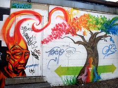 Fire Shaman and Rainbow Tree (Georgie_grrl) Tags: friends streetart toronto ontario graffiti alley expression creative photographers social figure meditation colourful seated outing rainbowtree cans2s mydarkpinkside samsungd760 torontophotowalks topwgyf fireshaman goodvibesforspring