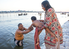Pilgrims Bathing In Ganges, Maha Kumbh Mela, Allahabad, India (Eric Lafforgue) Tags: travel family people india tourism water festival river outdoors photography bath asia day child religion bank event spirituality bathing hinduism pure sari pilgrimage religiouscelebration pilgrim sangam humaninterest allahabad socialgathering haridwar purification 1071 gangesriver yamunariver uttarpradesh realpeople kumbhmela traveldestinations colorimage indianculture fulllenght uttarakhand indiansubcontinent traditionalcloth celebrationevent traditionalceremony mixedagerange indianethnicity