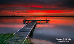 Sunset @ Squids Ink Jetty (Kiall Frost) Tags: longexposure blue sunset red sky orange lake green water grass clouds newcastle wooden nikon purple belmont jetty australia le lee nsw nd filters lakemacquarie oldjetty squidsink kiallfrost d800e