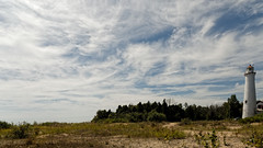 Sturgeon Point Lighthouse (joeldinda) Tags: tree 2016 park sturgeonpointlighthouse lighthouse underbrush 3235 august beach water waterfront sky light cloud