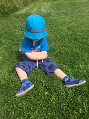 Thwarted... (A No NY Mouse) Tags: child boy pout hat blue green sward turf grass feet arms folded grumpy sulk tag cute