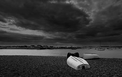 Calm before the Storm (Susie Potter) Tags: blackwhite boats river water bawdsey shingle sea clouds
