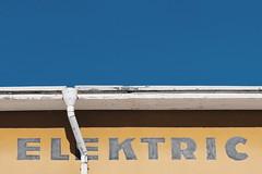 Elektric (Jani M) Tags: street urban horizontal line yellow blue drain wall sky elektric