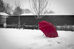 Red umbrella in snow (Pahas.) Tags: red snow cold umbrella frozen selectivecolorization flickraward5
