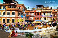 Boudhanath Temple - Nepal (3) (Mihai Sebastian Manole) Tags: travel nepal light people house color colors canon buildings temple construction natural case tibetan boudhanath crowded cladiri oameni 1635mm culori constructii templu aglomeratie