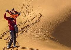 Oooops.....!!! (Explore(d) (Rosita So Image) Tags: people orange woman nature sepia desert candid textures morocco footsteps sanddune rippling woestijn ergchebbi strongwind sandduinen
