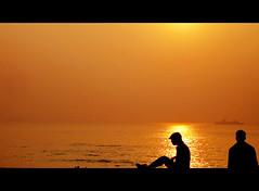 The brightest flame casts the darkest shadow.   George R.R. Martin (Satyadeep K) Tags: street travel sunset sea people india beach nature sunrise vizag visakhapatnam