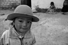 Cerca de la frontera entre Per y Bolivia (askya) Tags: bw peru children landscapes child border bolivia per borders biancoenero boarder pecore pecora
