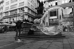 bubble magic (temmee) Tags: vienna wien city travel summer blackandwhite bw travelling monochrome canon eos austria soap scenery europe magic wide wideangle scene bubble 32 15mm 2012