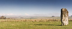 Watching O'er the land (stewartl2010) Tags: england panorama fence landscape countryside other unitedkingdom bluesky hills fields wiltshire stitched rolling avebury stonecircle longshadows sstones