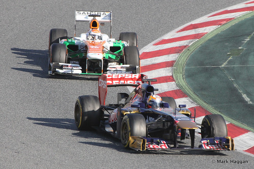 Jean-Eric Vergne's Torro Rosso leads Adrian Sutil's Force India in Formula One Winter Testing, March 2013