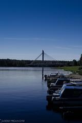 The Jtknkynttil Bridge (k009034) Tags: bridge sky lake beach canon finland boats photography photo harbour rovaniemi lapland northern arcticcircle distant northernhemisphere jtknkynttil