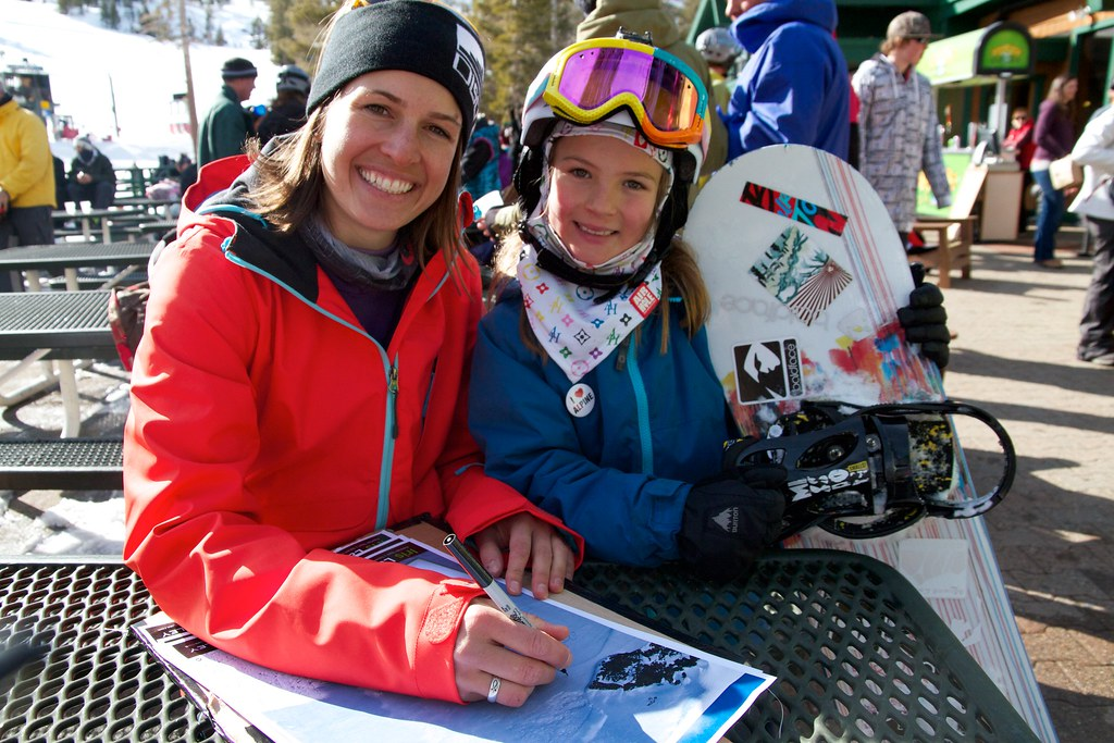 Iris Lazz signing posters at the Jr. Freestyle Series