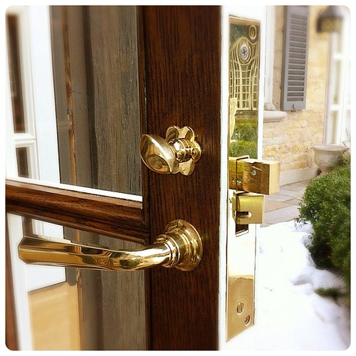 David Adler door hardware, unlacquered brass