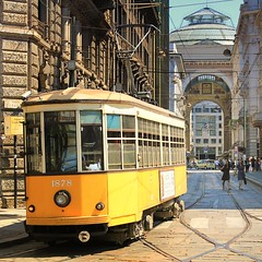 I Tram di Milano  Milans streetcars anno 1928 (Bn) Tags: street city blue summer sky italy sun holiday money milan hot history window public weather shop shopping walking square cuisine louis warm italia catholic cathedral roman trolley milano pigeons centre transport sightseeing tram sunny tourist gucci milaan ii covered di series network marble piazza duomo exquisite middle prada 1928 topf100 tramway ages 1500 galleria twentyeight romans attractions emanuele vittorio rete duomodimilano streetcars vutton 35c 1878 1386 100faves atmospheres tranviaria dommdemilan milans tramatmserie1500