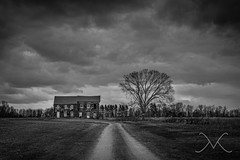 Abandoned History (Michael Ver Sprill) Tags: road blackandwhite bw house cold tree mike field rain clouds rural landscape 50mm michael newjersey scary moody gloomy cloudy urbandecay fineart nj haunted creepy civilwar jersey land lonely dirtroad battlefield scape longroad mv rundown depressing ver d800 lightroom americanhistory tonemapped stormbrewin sprill versprill photographyforrecreation michaelversprillcom