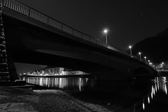 Light around the bridge (frizsala) Tags: water lake river light canon lecco italy night bridge white black bw