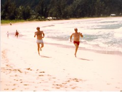 Dad Racing Uncle Bob on the Beach - c1983 (kimstrezz) Tags: 1983 familytriptohawaiic1983 hanaleibay kauai dad unclebob
