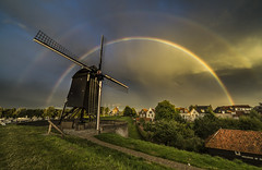 A little luck after heavy rain .... (johan de Cocq) Tags: rainbow dutch windmill ngc rain heusden netherlands