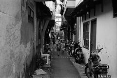 Rascals (Purple Field) Tags: leica m3 rangefinder minilux summarit 40mm f24 fuji neopan iso400 presto bw monochrome film analog 35mm jakarta indonesia street alley walking bicycle