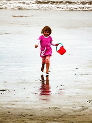Light Footed (Steve Taylor (Photography)) Tags: bucket running belt white brown pink fun happy sand water newzealand nz southisland canterbury christchurch newbrighton beach ocean pacific sea waves reflection