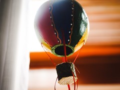 Flying out (BAndreoli) Tags: analoglens backlight balloon calm colorful courtain cozy decoration flying fuji fujifilm hotair indoors industar life mechanicallens object ornament peace room sky still stilllife sun sweet window windowlight wood xe1