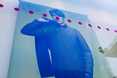 2748 miles since (lille abe) Tags: chengdu china street poster man nose dots red blue uniqlo fuji michal pachniewski