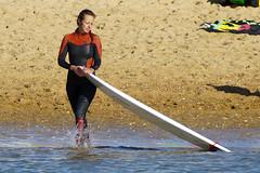 cleaning up the board (Curufinwe - David B.) Tags: beach sea mer mimizan landes aquitaine france sony a77 a77v sonyalpha77 sonydslta77v 400mm sigma plage waves wave surf surfing wetsuit girl girls woman feminine surfer surfgirl surfergirl surfcamp