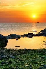 Tales from the sea (Mario Ottaviani Photography) Tags: sony sonyalpha sea seascape dawn alba italy italia paesaggio landscape travel adventure nature scenic exploration view vista breathtaking tranquil tranquility serene serenity calm walking tales boat alghe reefs scogli