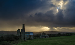 Crepuscular Mine (intrazome) Tags: travel sunset england cloud sun storm nature beautiful rain weather clouds outside outdoors shower countryside nikon cornwall country rays sunbeam cloudscape sunbeams d5100