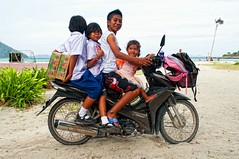 How many Thai people can you get on a motorbike? (Amsterdam Today) Tags: road school people beach beautiful children thailand island one countryside crazy dangerous child traffic symbol families motorcycles scooter adventure most national ko thai vehicle safe piece moped popular koh stay entire lipe motobike