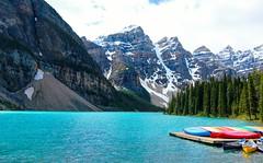 Canoes at Moraine Lake (Cole Chase Photography) Tags: canada canon landscape banff lakelouise albertacanada banffnationalpark t3i morainelake canadianrockies valleyofthetenpeaks turquoiselake rockflour