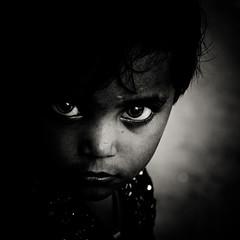 Entropie (Christine Lebrasseur) Tags: travel portrait people blackandwhite india france art 6x6 girl canon child onblack in madhyapradesh 500x500 challengeyouwinner ltytrx5 khajurâho allrightsreservedchristinelebrasseur