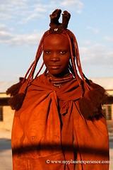 Traditional Himba woman - Namibia (My Planet Experience) Tags: africa portrait woman canon african experience afrika tribe namibia himba afrique opuwo stockphotography herero namibie kaokoland kunene namibe namibi namiibia     namibya namibio  otjize   nabimian wwwmyplanetexperiencecom myplanetexperience