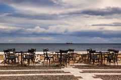 Tables with view (Theophilos) Tags: sea sky clouds ship view chairs crete tables rethymno