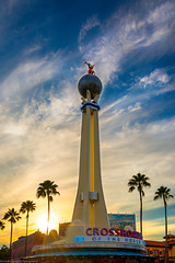 Crossroads of the Sun and the Sky (Explored) (TheTimeTheSpace) Tags: sunset sun clouds nikon bluesky disney mickey palmtrees disneyworld waltdisneyworld d800 crossroadsoftheworld matthewcooper hollywoodstudios thetimethespace