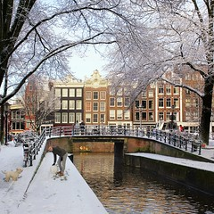 Reliving childhood memories when building a snowman (Bn) Tags: world street bridge trees windows winter light sunset people dog sun house snow man cold holland heritage church water netherlands dutch amsterdam weather bike corner walking frank anne bo