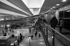 Strolling around (DavidAndersson) Tags: people blackandwhite monochrome mall shopping nordstan gteborg sweden gothenburg eon femman femmanhuset tamron18200f3563